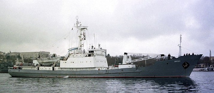 In this file photo taken on Friday, April 2, 1999, Russian Navy reconnaissance frigate Liman leaves from the Russian Black Sea fleet's base at Sevastopol, Crimean peninsula. Russia's Defense Ministry reported Thursday April 27, 2017, that the Liman naval reconnaissance ship has collided with another ship about 40 kilometers (25 miles) northwest of the Bosphorus Strait, and is in danger of sinking in the Black Sea.