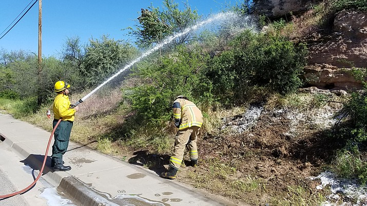 Cottonwood firemen douse a brush fire along Main and Seventh streets last week. (City of Cottonwood courtesy photo)