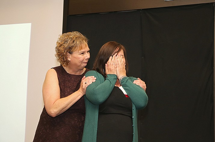 Cindy Daniels, assistant superintendent for the Chino Valley Unified School District, congratulates Glassford Hill Middle School's Jessica Marks, who was named the 2017 overall teacher of the year for Yavapai County on Friday by the Yavapai County Education Foundation. (Matt Santos/Courtesy)