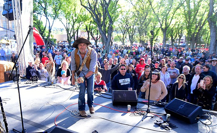 Roger Clyne entertains the many bike racers and supporters during the Whiskey  Off-Road Music Festival Sturday night in downtown Prescott. (Les Stukenberg/Courier)
