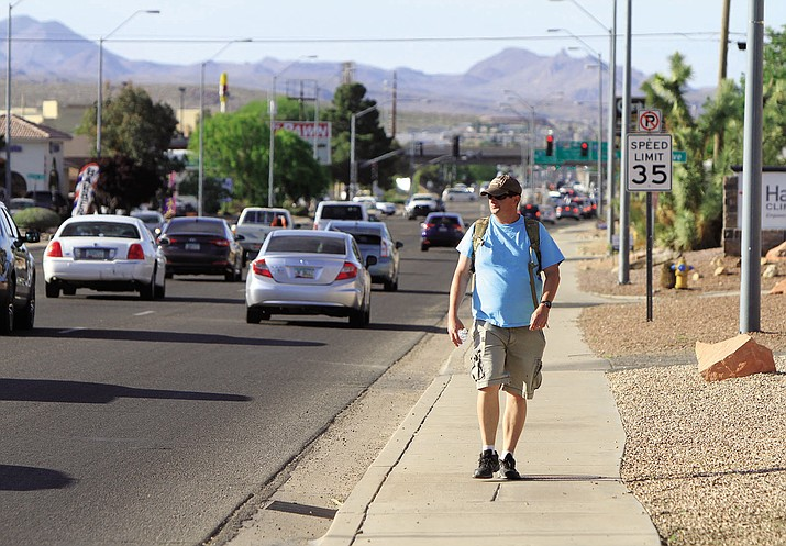 Kingman Daily Miner reporter Aaron Ricca walks home from work Thursday along Stockton Hill Road.