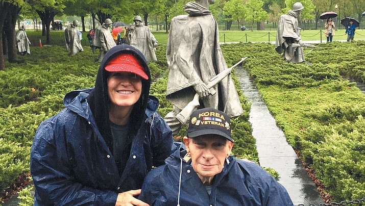 Louis Shannon with guardian Cheryl Hassoldt at the Korean War Memorial.
