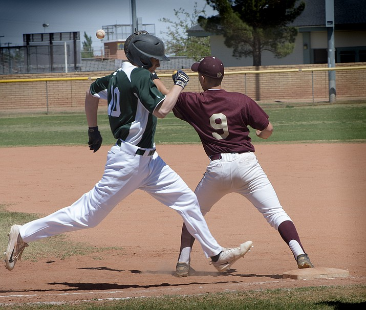 Nolan Robertson gets an out at first base. Photo/Todd Roth