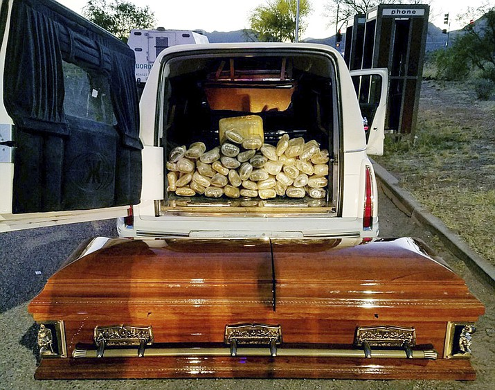 This Saturday, April 29, photo shows a hearse, the casket and the bricks of marijuana it was carrying after agents stopped the vehicle at an immigration checkpoint on State Route 80 near Tombstone.