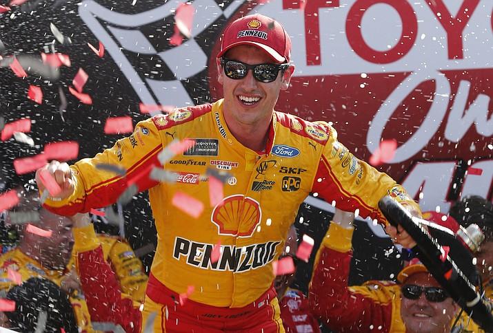 Joey Logano celebrates after winning the NASCAR Cup Series auto race in Victory Lane at Richmond International Raceway in Richmond, Va., Sunday, April 30, 2017. (Steve Helber/AP)