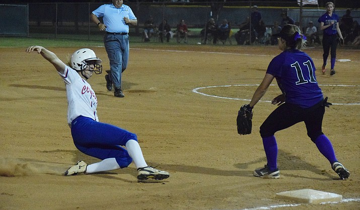Camp Verde senior Kayla Hackett slides into third base after hitting a triple during the Cowboys' 10-2 win over No. 13 Arizona College Prep in the first round of the state tournament at Rose Mofford Sports Complex.  (VVN/James Kelley)