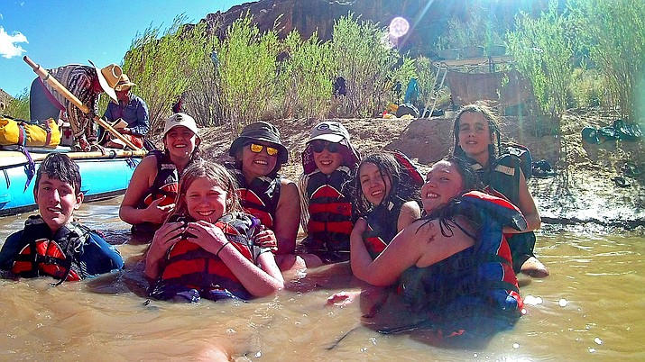 Students play around in the San Juan River after a day of rafting.