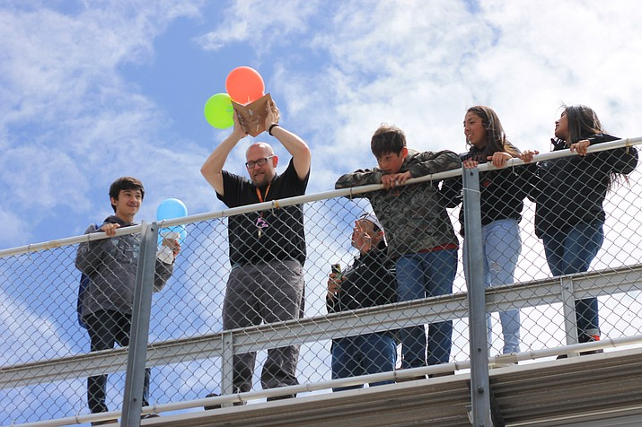 Williams High School science teacher Michael Lee pitches student's packaged raw eggs off the football bleachers April 26.