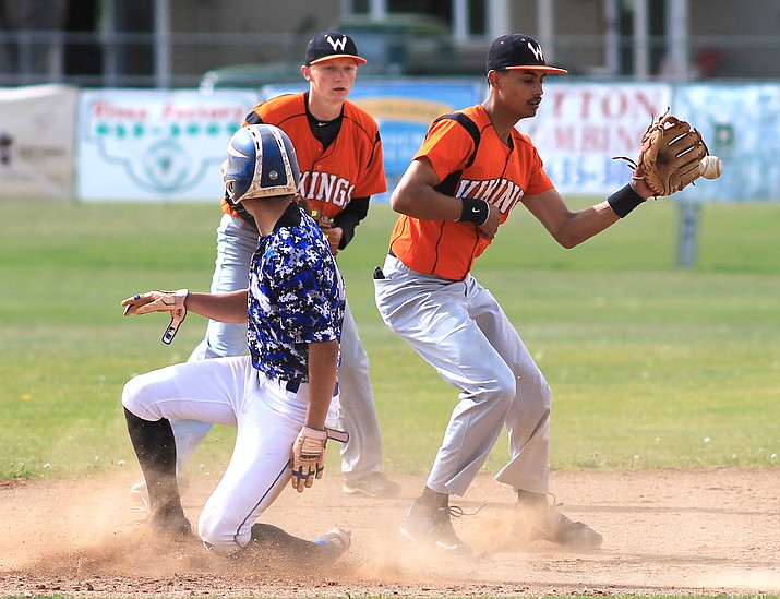 Vikings shortstop Daniel Lopez attempts to get a Bagdad runner out at second as Payce Mortensen backs him up.