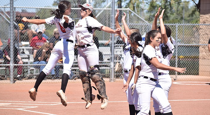 Mingus Union softball players chest bump during the pregame introductions at Salpointe Catholic on Saturday. Though the Marauders lost 12-0, it was their first state tournament appearance since 2013. (VVN/James Kelley)