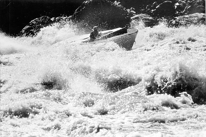 "Otis ""Dock"" Marston navigates a speed boat through Lava Falls rapid circa 1963."