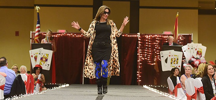 Ana Johnson models fashions from Lolo's Grace/Laurel Cook during the Women's Council of Realtors Prescott annual Fashion Show at the Prescott Resort Tuesday, May 2.  (Les Stukenberg/Courier)