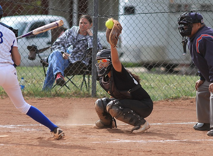 Vikings catcher Jaden Alvarado stops the ball during the game with Bagdad April 26.