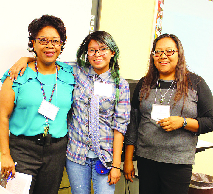 Dushon Monongye and Cecilia Shorten led a session on getting money for college. Lorene Nequatewa (center) learned about college costs. Photo/Stan Bindell