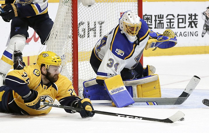 Nashville Predators left wing Harry Zolnierczyk (26) falls as he tries to shoot against St. Louis Blues goalie Jake Allen (34) during the second period in Game 4 of a second-round NHL hockey playoff series, Tuesday, May 2, 2017, in Nashville, Tenn. (Mark Humphrey/AP)