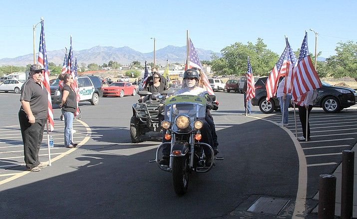 The PGR escort arrives at the church while the flag line stands.