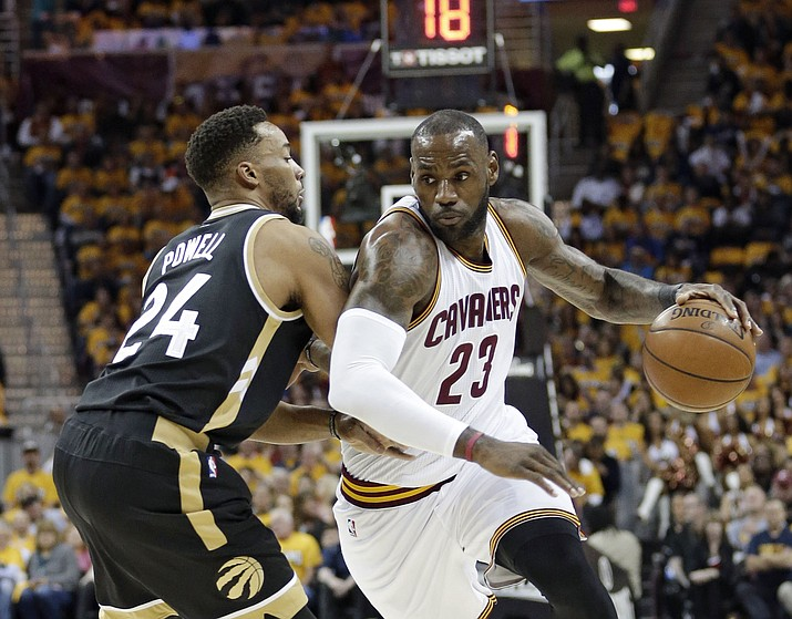 Cleveland Cavaliers' LeBron James (23) drives against Toronto Raptors' Norman Powell (24) during the first half in Game 2 on Wednesday, May 3, 2017, in Cleveland. (Tony Dejak/AP)