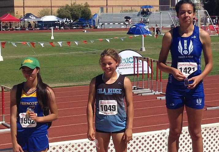 Prescott's Sarah Nguyen, far left, holds up her fourth place medal in the triple jump at the Division II State Track and Field Championships on Wednesday in Mesa. (Badger Athletics/Courtesy)