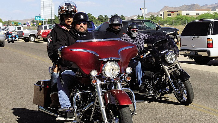 Shawn and Josie Carson from Palmdale, Calif. cruise down the street on a Harley-Davidson Street Glide.
