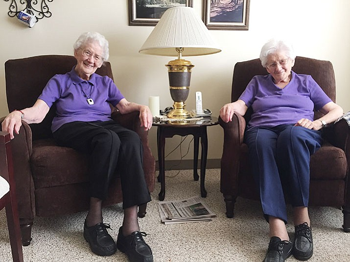 Emma Weiss (left) and Anna Parker are twin sisters who will be turning 100 later this month. (Max Efrein/Courier)