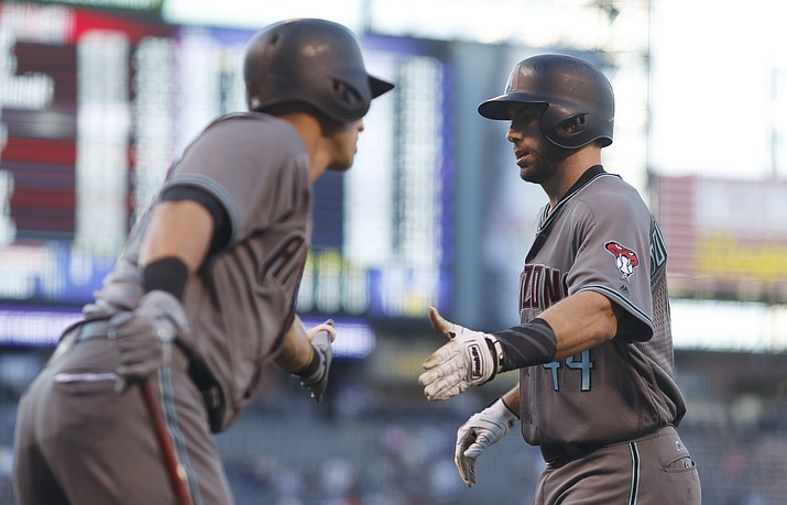 Arizona Diamondbacks' Paul Goldschmidt, right, is congratulated by Jake Lamb after hitting a solo home run against the Colorado Rockies in the first inning of a baseball game Friday, May 5, 2017, in Denver. (David Zalubowski/AP)