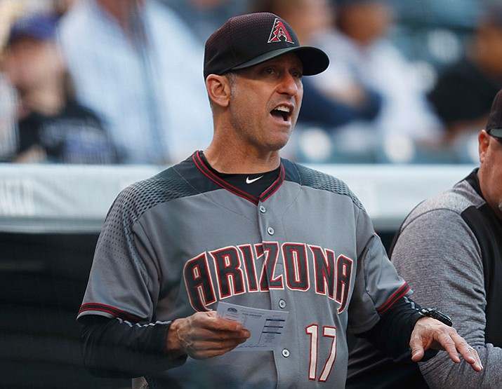 Arizona Diamondbacks manager Torey Lovullo directs his team against the Colorado Rockies in the first inning of a baseball game, Saturday, May 6, 2017, in Denver. (AP Photo/David Zalubowski)
