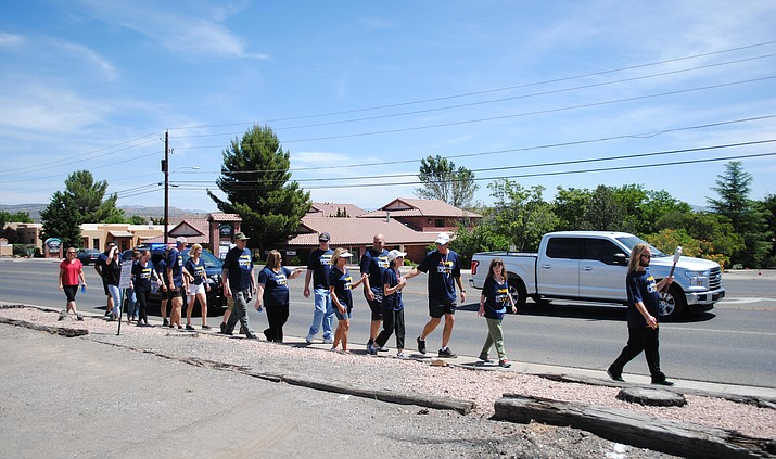 Sedona hands off the torch to Cottonwood during the law enforcement torch run at the 1000 block of Main Street in Cottonwood May 2. (VVN/Jennifer Kucich)