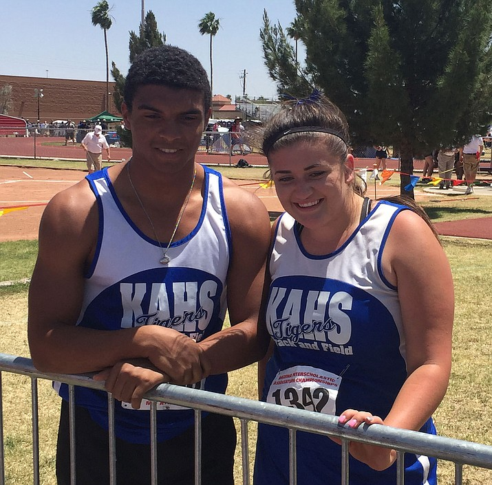 Kingman Academy's Jordan Seybert, left, and Amberlee Steed pose during the Division IV Track and Field State Championship at Mesa Community College.