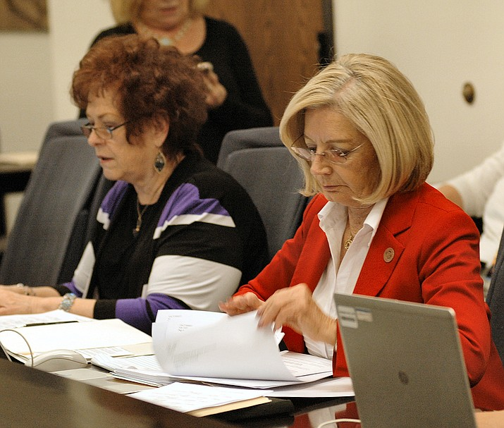 Sens. Sylvia Allen, left, and Karen Fann review details of the proposed $9.8 billion spending plan ahead of floor debate Thursday. (Capitol Media Services photo by Howard Fischer)