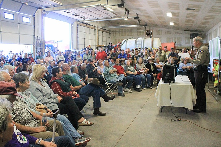 Coconino County Sheriff Jim Driscoll addresses a crowd at High Country Fire Rescue May 6. Driscoll answered questions about burglaries and a recent double homicide that occurred in the Red Lake area.