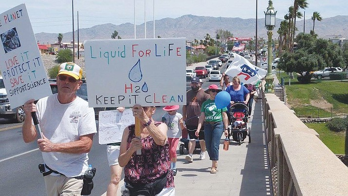 "Mohave County Democrats ""marched for science"" on Earth Day over London Bridge in Lake Havasu City."