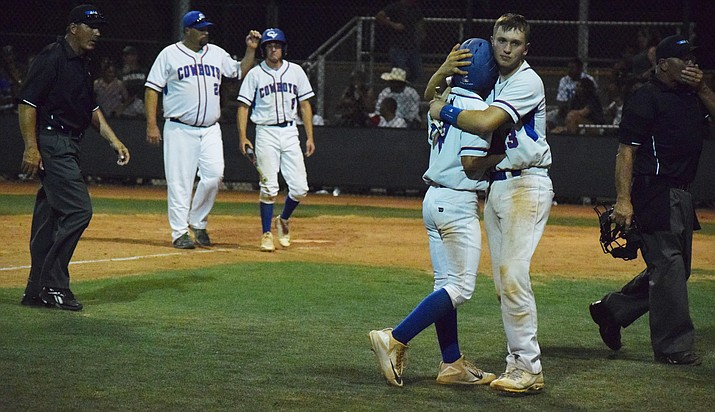 Camp Verde seniors Wyatt Howe (left) and Easton Braden (right) hug after the Cowboys' first-round loss to Miami at Goodyear Baseball Complex on Friday night. Camp Verde rallied from a six-run deficit but lost in the seventh inning. (VVN/James Kelley)