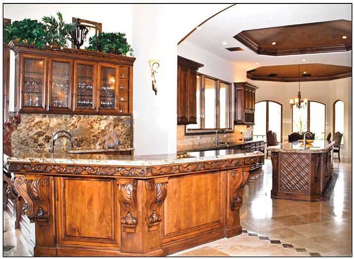 Elegant custom cabinets for a custom space because of the shape of the room.