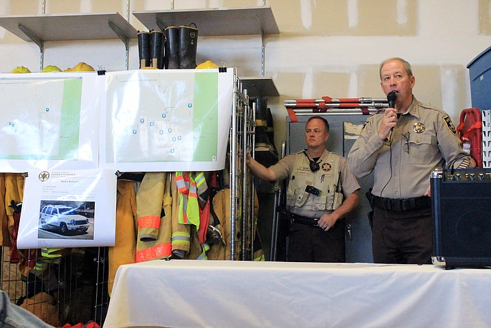 Sheriff Jim Driscoll and Lieutenant Brian Tozer of the Coconino County Sheriff's Office stand next to maps of burglaries that have occurred in the Red Lake area of Williams in 2016 and 2017.