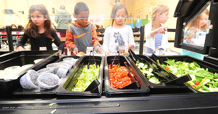 First grade students at Coyote Springs Elementary School get their hot lunch in the school's cafeteria Tuesday, May 9 in Prescott Valley. (Les Stukenberg/Courier)