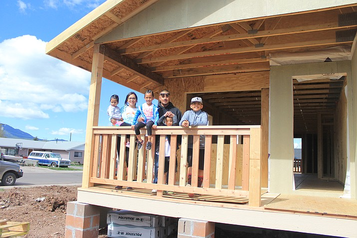 Christina Hernandez and Jose Martinez stand on the front porch of their new Habitat for Humanity home with their children Anthony, Jose, Joanna and Veronica Martinez.
