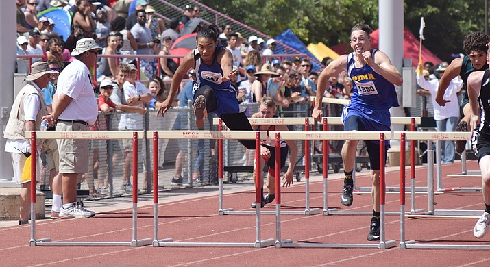 Camp Verde sophomore Chris Holdgrafer (left) clears the last obstacle in the 110m hurdles at the Division III state championships at Mesa Community College on Saturday. Holdgrafer finished in second place in the 110m hurdles and set a personal record. (VVN/James Kelley)