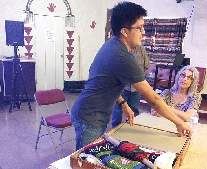 Lance Dawavendewa opens up a suitcase of his weaving and handmade tools at the Prescott Unified School District Native American Families Night at the Smoki Museum last week. (Nanci Hutson/Courier)