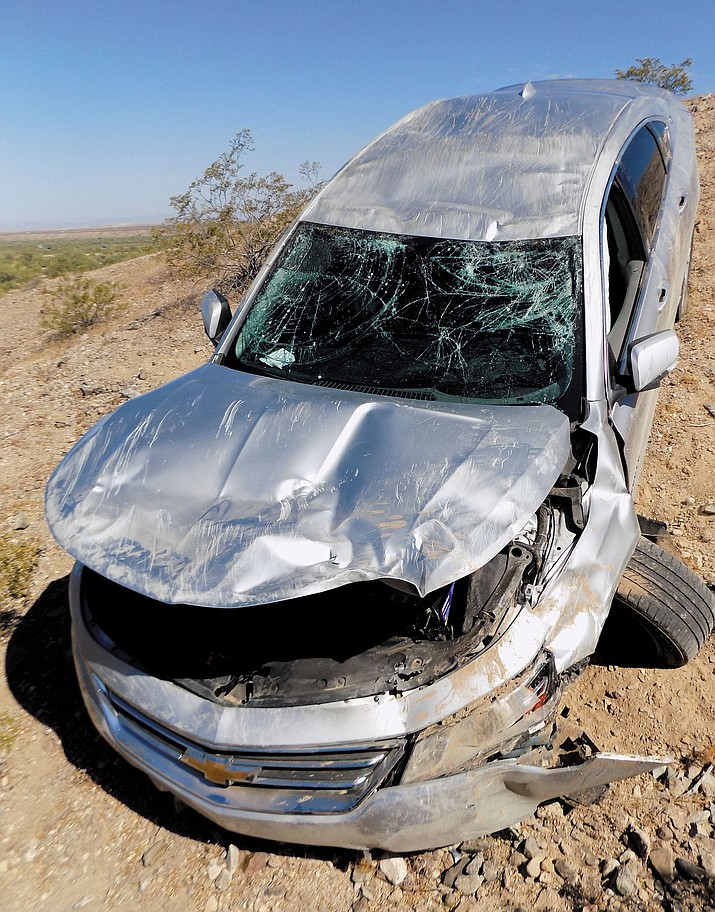 Two Kingman residents were injured, but later released, after this single car rollover near Lake Havasu City Sunday.