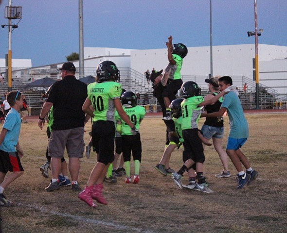The Prescott Valley Hitmen youth football program's 10-year-olds team celebrated a come-from-behind victory over the Surprise Scorpions in the semifinals April 29. (PV Hitmen/Courtesy)