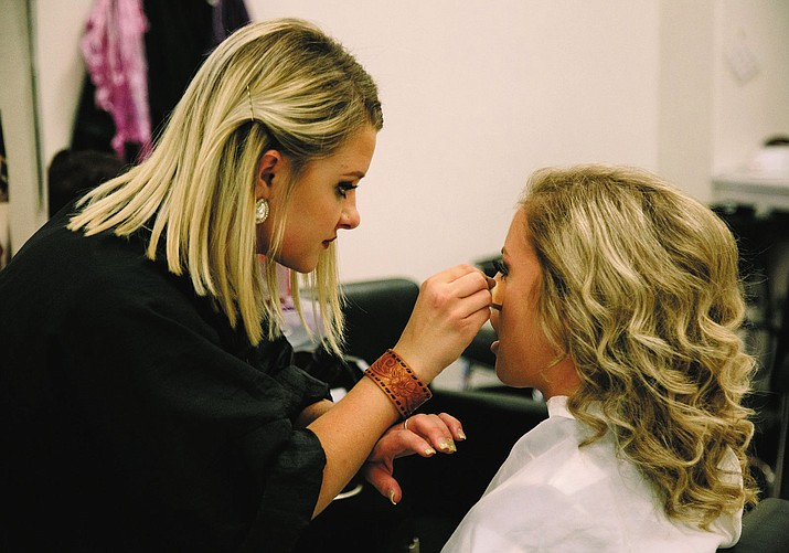 All Beauty College student Casey Wurm with her client Bailey Hammond from Kingman Academy High School.