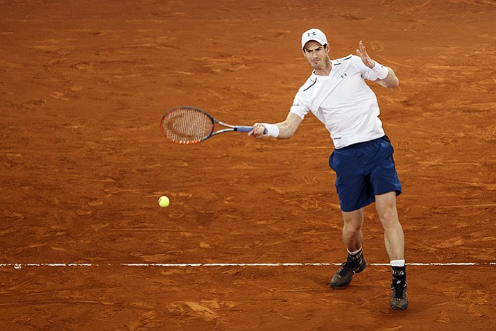 Andy Murray from Britain returns the ball during a Madrid Open tennis tournament match against Borna Coric from Croatia in Madrid, Spain, Thursday, May 11.