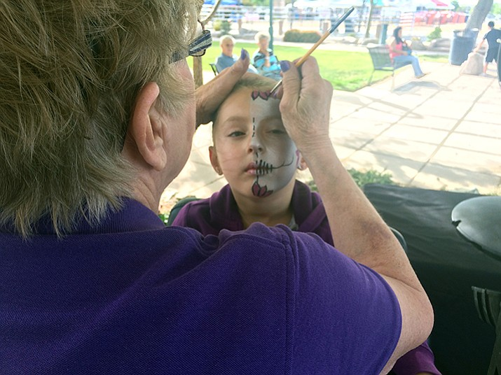 Avery Cardenas gets her face painted by Diane Smith at Prescott Valley Days on Friday, May 12. (Jason Wheeler/Courier)