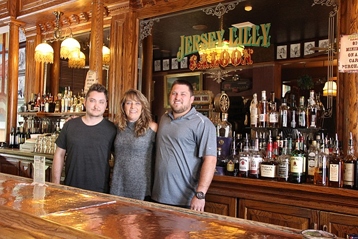 Andre Defreitas, left, Susan Roberts and her son, Josh Makrauer, are the new owners of Jersey Lilly Saloon. (Max Efrein/Courier)