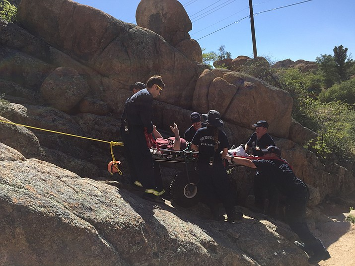 Members of the Prescott Fire Department use a Stokes basket to haul a 53-year-old hiker nearly half a mile out of the Flume Trail in the Granite Dells on Saturday, May 13, in Prescott.
