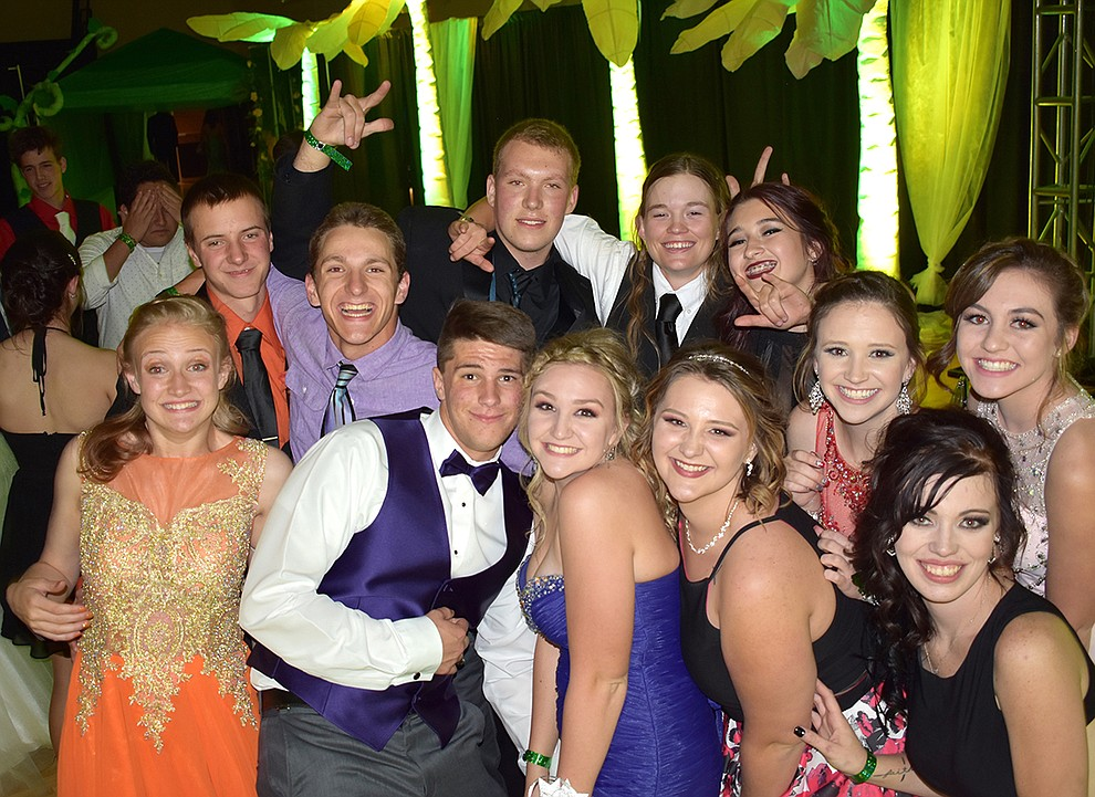 "Bradshaw Mountain High School students celebrate during, ""Wild Nights,"" their jungle themed prom held at the Humboldt Unified School District offices Saturday, May 13, 2017."