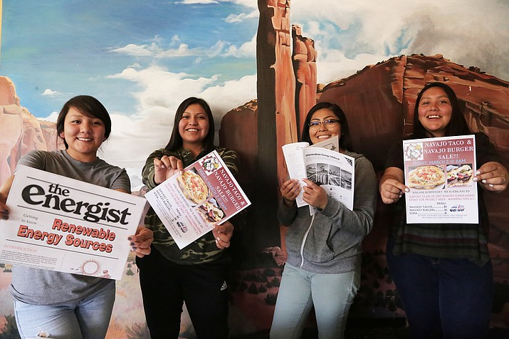 Native American students hold posters designed to attract attention to energy issues on the Navajo and Hopi reservations and throughout Arizona. Submitted photo