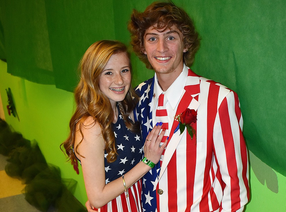 Nikala Calia, 16, and Blake Huntley, 18, turned heads at the Bradshaw Mountain High School prom Saturday night when they showed up in Stars and Stripes formalwear.