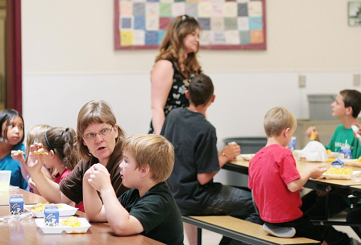 School districts across the Verde Valley will provide free meals during the summer through the U.S. Department of Agriculture's National Summer Food Service Program. Pictured, children enjoy their lunch at Beaver Creek School in Rimrock. (Photo by Bill Helm)
