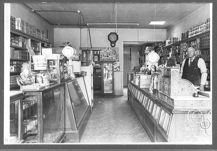 A Williams store owner greets customers in the 1920s. This photo, along with thousands of other historic Williams photos, are being collected and displayed at the Williams Visitor Center.